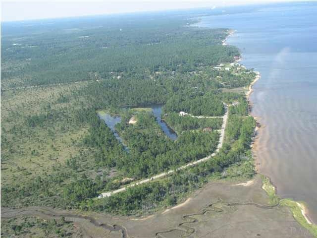 """GATED"" WATERFRONT COMMUNITY LOCATED ON EAST BAY. SEWER AVAILABLE-NO SEPTIC TANKS. COMMUNITY BEACH/PARK, ASSOCIATION DUES $350/year. LEVEL CORNER LOT ON CUL DE SAC, HEART OF SEA PINES ACROSS FROM EAST BAY. 2002 SURVEY AVAILABLE. SEE ATTACHED. DEVELOPER IS LISTING AGENT & AVAILABLE ANYTIME FOR QUESTIONS."