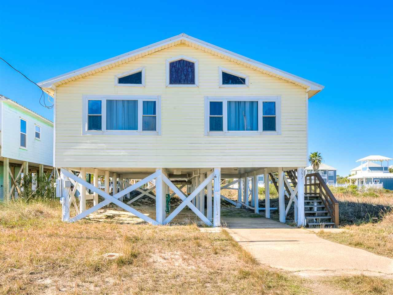 Your Beach Home Awaits! Only a few steps away from standing in the white sands of the Alabama Gulf Coast. The space is a wonderful area to spend quality family time. Short walk to the beach with incredible views of the Gulf of Mexico and Mobile Bay in the short distance. Truly a place to get away from the daily grind. Come home and relax in this great beach home! Nicely furnished and rent ready! Covered parking under house. Close to Boat Launch and Marina. Jump on this one, it won't last long! Text, call, or email me anytime. YOUR REALTOR FOR LIFE.