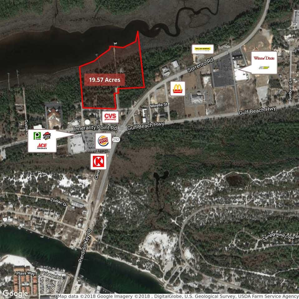 """Rare developer opportunity to purchase 19.57+/- acres of waterfront land in Pensacola, FL. The property would be an excellent site for a possible condo or residential development with its prime location just over the bridge from the Perdido Key beaches. The site consists of 6 contiguous parcels with over 1,378 feet of frontage along Bayou Tarcon. 16.57+/- Acres of the property is zoned """"C-1"""", Commercial District, which allows for a variety of commercial and residential uses. The remaining 3+/- acres of the site is zoned """"SDD"""", Special Development District which allows a maximum density of 3 dwelling units per acre. The site could potentially be developed with a total of 423 dwelling units under the current zoning laws. The property features"""