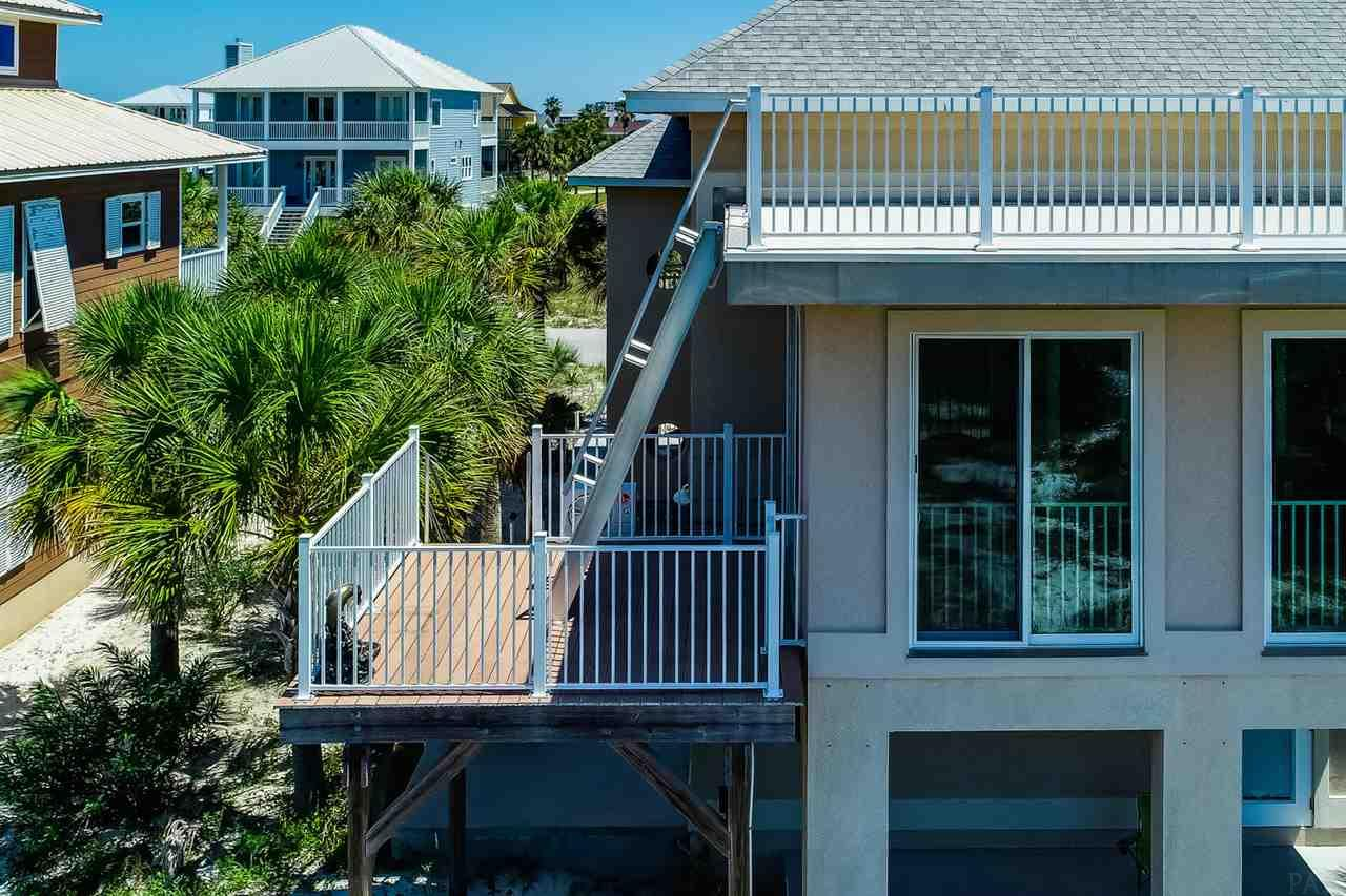 Completed in 2008, this is your DREAM HOME awaits in the coveted subdivision of PERDIDO KEY COVES, This CUSTOM ICF home is a 4550 square ft. 4/3 with over 700 square ft of OUTSIDE PORCHES & BALCONIES  to view GORGEOUS SUNSETS over OLE river and THE GULF.. Projected rental is $80k with Resort Quest and another 15% if a pool is added...perfect for Weddings! This beauty is surrounded by the Perdido state park these views remain! PLUS  the first floor has a 38'x17'' EFFICIENCY APT./BONUS ROOM with full kitchen , bathroom, W/D hook ups and 10x20' PORCH ATTACHED. WALK across the street to your SUGAR WHITE SAND beach owed by the state and nada can be built on it! This is all about LOCATION, LOCATION and one more time-LOCATION:)!! ..10 minutes to P