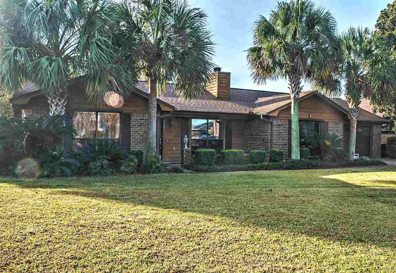 Treat yourself and your family to a great home where every season is beautiful!  Located on a deep canal that flows directly into Pensacola Bay.  100' on the water with a boat lift.  3 bedrooms 2 full bathrooms +  490 sq.ft. Sunroom (not included in the sq.ft.) with plenty of room for family enjoyment and a 465 sq.ft.  screened porch.  This home is brick and cedar (termites hate cedar).  Vaulted ceiling, crown molding, living room with wood burning fireplace. Flowing floorplan that opens into the large dining area and kitchen.  Solid w cabinets with a stacked design, granite counters, microwave, fridge and smooth top range. Tile in all wet areas.  Split floor plan with a large master, walk in closet, master bath with tub/shower.  2 nice siz