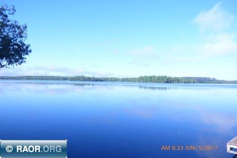 This beautiful lot on Stingy Lake is almost 4 acres. It has a very gentle slope to lake with hard sand bottom and has been cleared for campsite or building site. Stingy Lake is great for Northern, walleye and pan fish. You don't even need a boat. You can fish right off your dock. Close enough to town that you can camp all week and still go to work. 200 feet of lake shore and dock included.