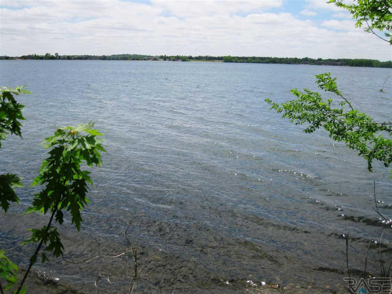 MOTIVATED SELLERS -- HUGE price reduction on this 12 acre parcel with TERRIFIC LAKE FRONTAGE and channel that winds through property.  One of the last undeveloped properties on Lake Madison and POSSIBILITIES ARE ENDLESS!! This parcel stretches from Hwy. 34, passed Dakota Avenue and to the water's edge.  It has been platted for residential lots, but would be perfect for your dream home, family compound or for investor(s) wanting to build lake homes.   Inventory is low, so could be a GREAT time for lake homes to be built.  Sewer and rural water are available and currently in place.