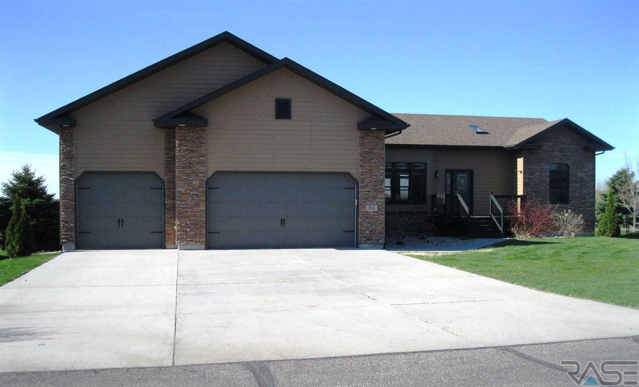 PRICE REDUCTION!!  TERRIFIC LOCATION -- Lake Golf Course!!   Golf greens front and back AND great view of Round Lake.  Plenty of curb appeal on this one, with partial stone front. Built in 2008, there is 1,720 sq. ft. on main level, with three bedrooms, 2 baths (master suite), triple car garage and Midland Carriage House doors.  Plenty of cabinetry and counter space in kitchen and stainless steel appliances are included.  Open floor plan with vaulted ceilings, Dura Ceramic flooring in kitchen and dining area, with large deck (13x16) off living area.  Master has trayed ceiling, great view of lake and large walk-in closet (8x8).  Master bath has whirlpool and shower.  Unfinished lower level is ready for new owner to finish and provide even more equity in this home.  This one is worth viewing!!