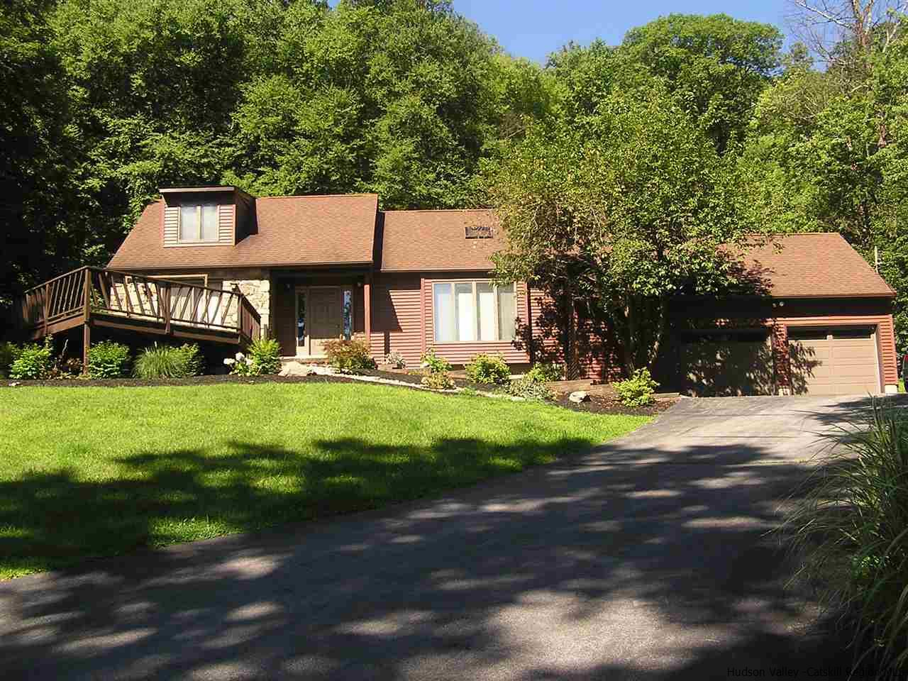 This is a must see won't last long at this price. Commuter friendly minutes to Mid Hudson Bridge, Train Station and NY State Thruway. This Home has an open floor plan Kitchen,Dinning Room and Living Room complete with stone Fireplace Cathedral ceiling and exposed wood beams. River Views from living area and also front deck. Home also has a great tree lined yard great for kids and family get togethers