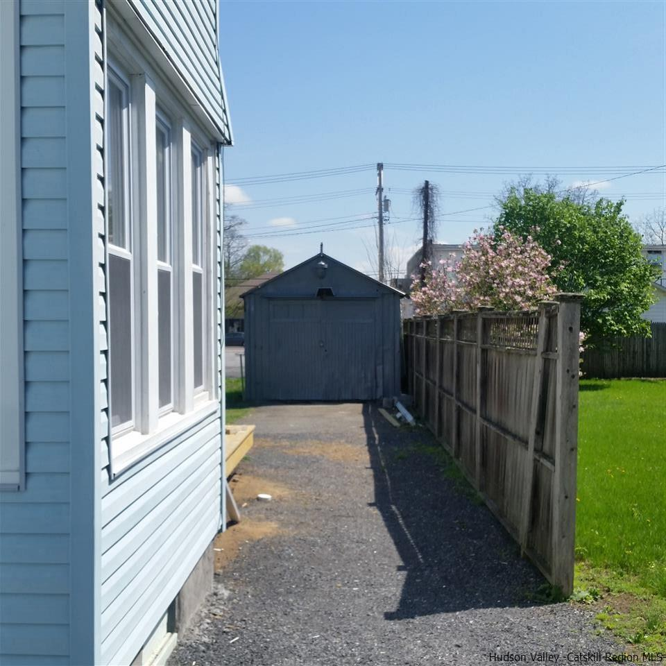 side yard, driveway and shed