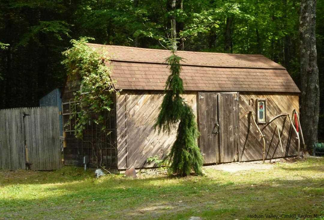 Several sheds on the property - one with electricity; great for workshop, arts and crafts or garden!