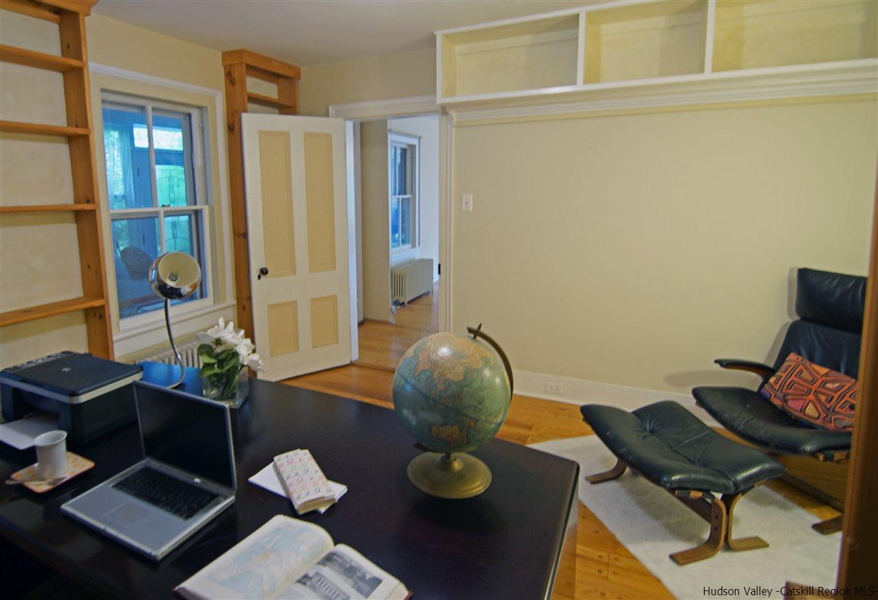 Just off the living room is another large office with built in shelves.