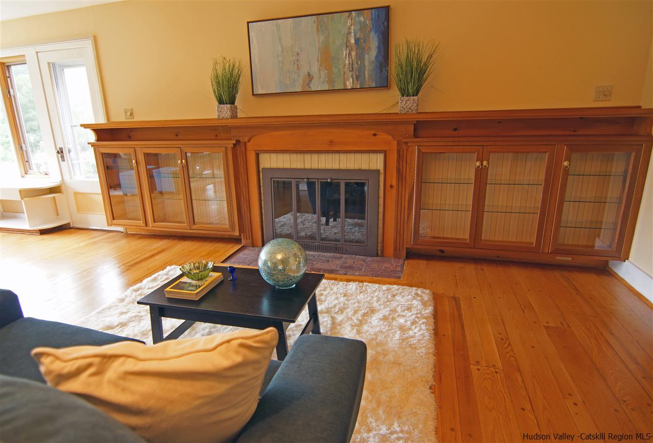 Custom cabinets surround the working fireplace