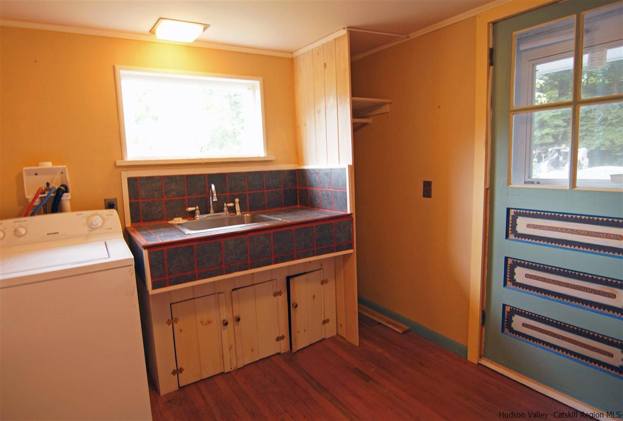 With its own separate entrance this laundry room also serves as a mud room.