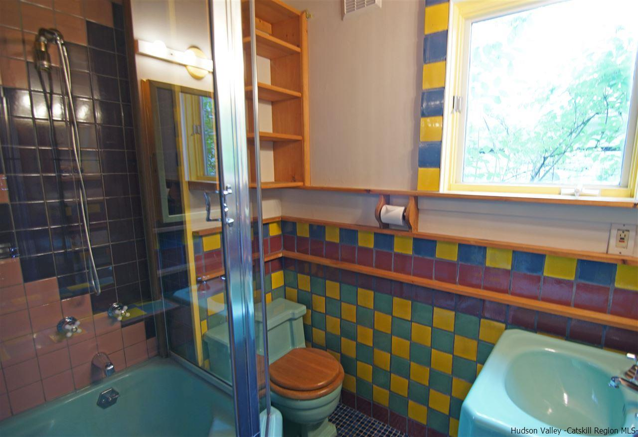 Private Bath for the den includes a steam shower.