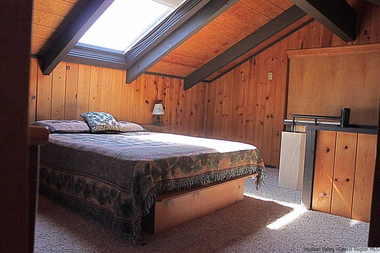 Bedroom #3 is a loft bedroom that serves as the master bedroom with private bath