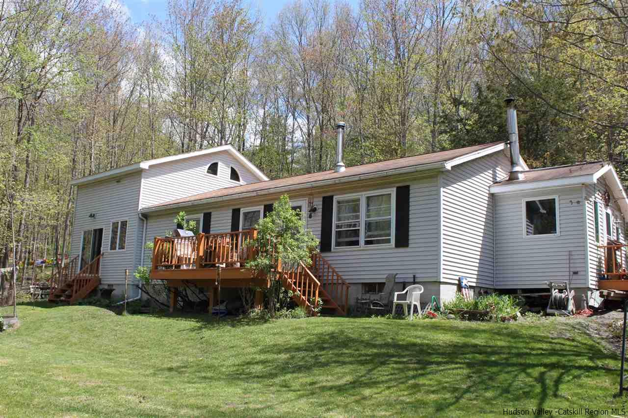 3 bedroom home with french doors, mud room, deck, pretty yard and one car garage.