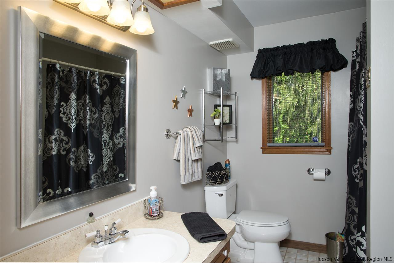 One of two full bathrooms in the single family Ranch.