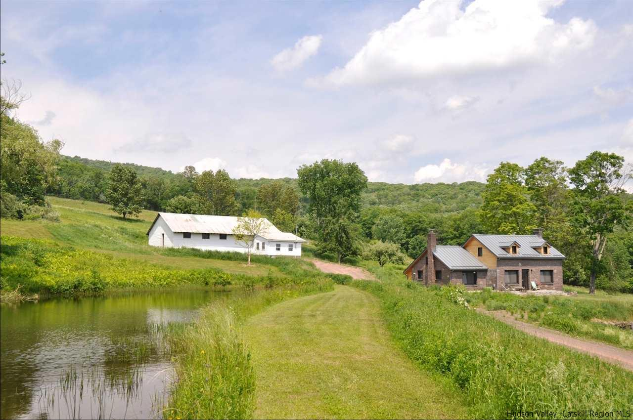 266 Bragg Hollow Spur Road exterior shot of home and barn