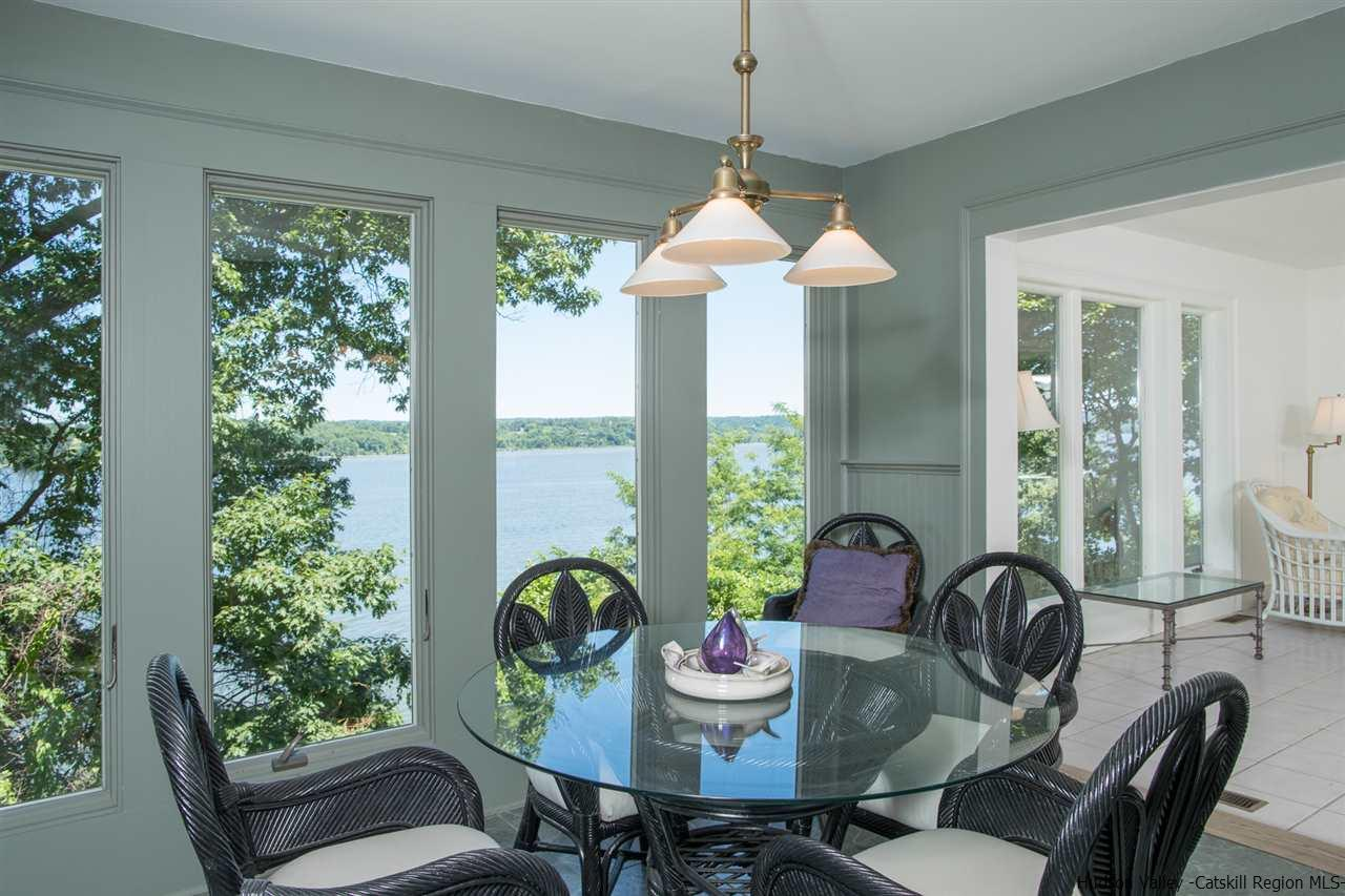 Enjoy watching life along the Hudson River while relaxing with your morning coffee.