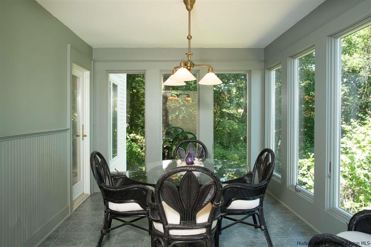 This peaceful space is accessible from the home office & dining area of the great room.