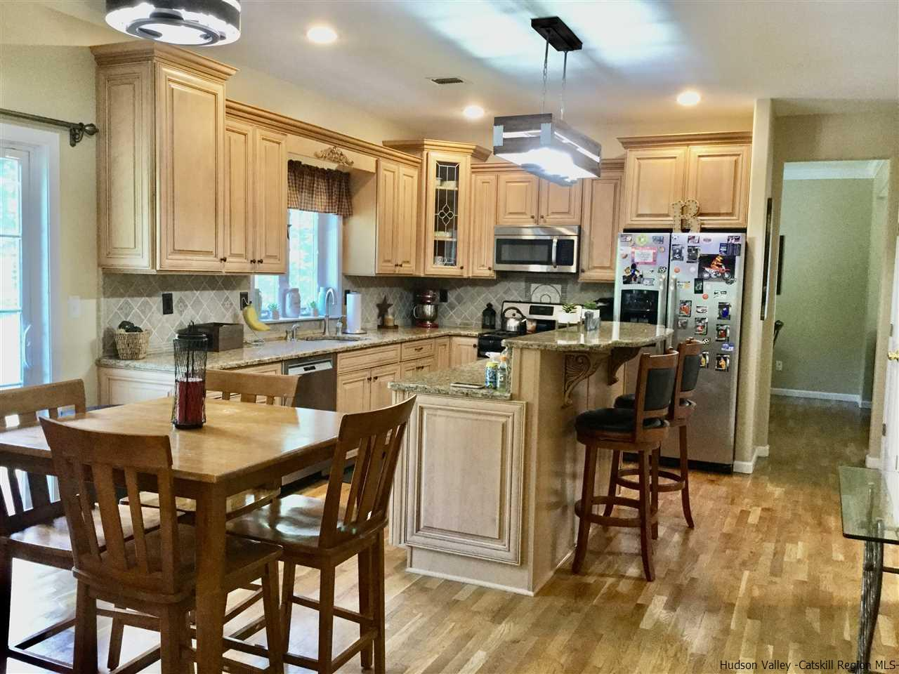 CUSTOM CABINETS ~  ISLAND  ~ PANTRY~ OPEN TO FAMILY ROOM~  DINING AREA ~  DOORS to DECK~