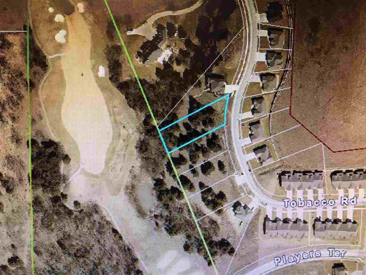 0.59 acre wooded lot on dead end street. Golf course frontage.  Low specials for the area.
