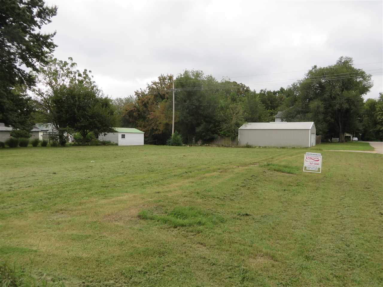 Large, corner 80x140' site that has been cleared and ready for new home. Has utilities underneath for easy hookup. Trees have been cleared and a survey done. Includes two city lots. Nice opportunity for single family home or duplex. Give Lakeside Properties a call for more information - (620) 767-5045