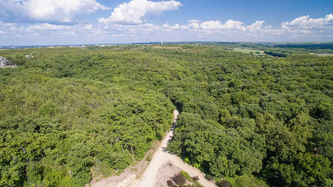"""You'll feel like you're not in Kansas, Toto!  Amazingly private and serene 20 acre building site just minutes from the west side of Manhattan off of Scenic Drive.  Owner has cleared a path to a potential building site.  Heavily wooded, rolling terrain with a """"meadow"""" type clearing for building your dream home.  Contact Jodi Thierer of Legacy Realty of Kansas to arrange your private viewing of this spectacular home site."""