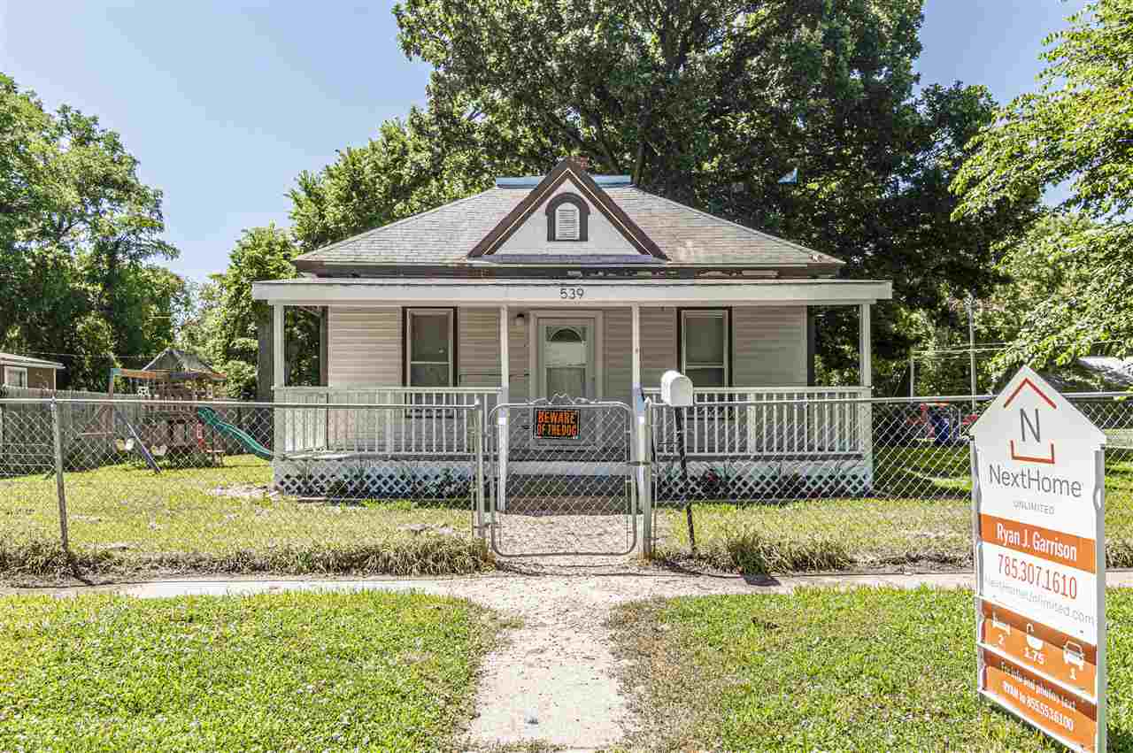 Take a look at this great investment opportunity. Situated on a large corner lot, this home has 2 bedrooms 1.5 bathrooms, with updated flooring. Would make a great fixer upper or rental home. Central Heating installed in 2016. Home has a full unfinished basement. For your personal showing call/text Ryan J. Garrison with NextHome Unlimited @ 785.307.1610.