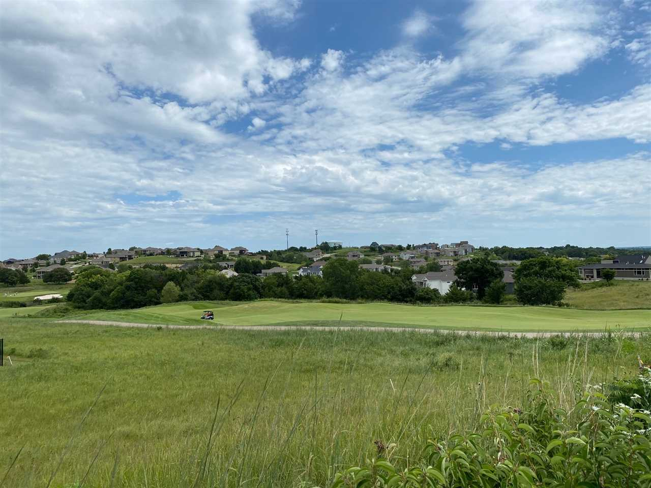 Build your dream home!  This lot has an incredible view of hole #10 and up the street from the Colbert Hills Clubhouse.  Enjoy evenings in the shade on your back patio/deck.  Manhattan school district- Bergman Elementary and Susan B. Anthony.
