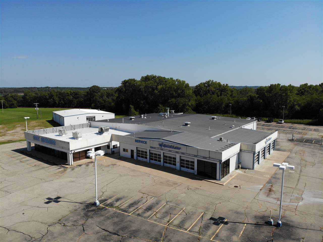 A Great Investment opportunity for a car Dealership or industrial business. This move in ready facility is 23,187 SF. Sale of property is required to be a business that collects sales tax.   Commercial area on located on a high traffic street.  https://youtu.be/PbFnIqotgA4