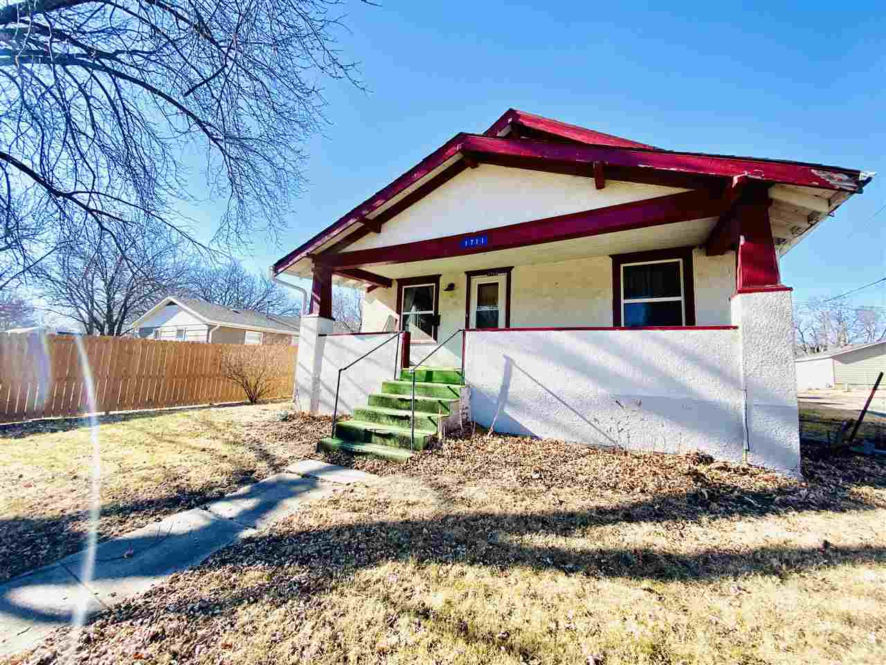 """Wonderful 2-3 bedroom, 1 bath Bungalow with original hardwood floors and gorgeous built-ins.  This is a fixer upper being sold """"as-is"""".  Lots of potential with main floor laundry, 2 car garage, and unfinished basement."""