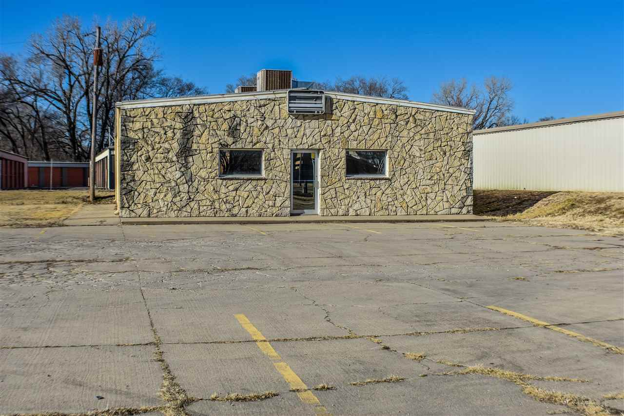 Great commercial property between to gates to Fort Riley on Grant Avenue. Open floor plan, so the building could be renovated for many different uses. Does have separate his and her bathrooms and office/storage room. Call Staci Schroeder to set up your private showing today.