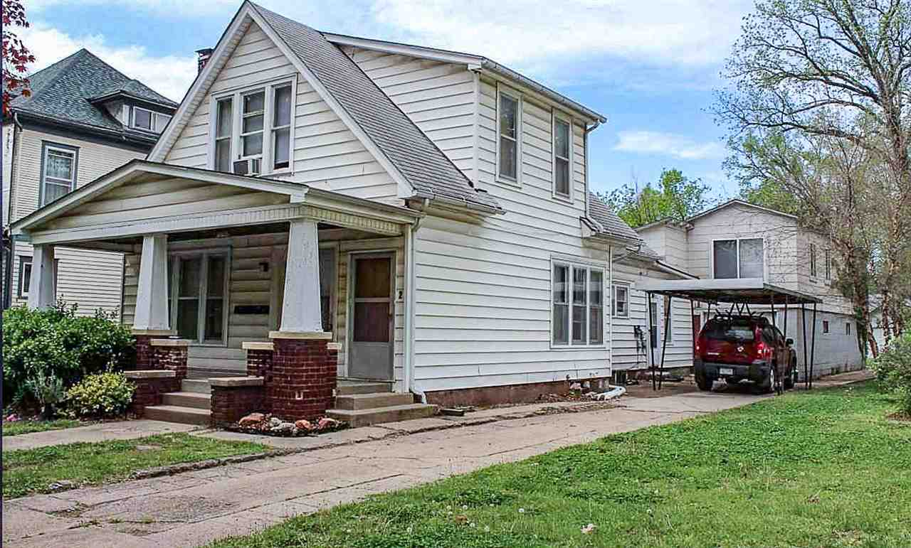 Triplex 5 blocks from Kansas State University Campus.  All units leased. $1945/mo gross rent. Garage and basement storage.  Off street parking.