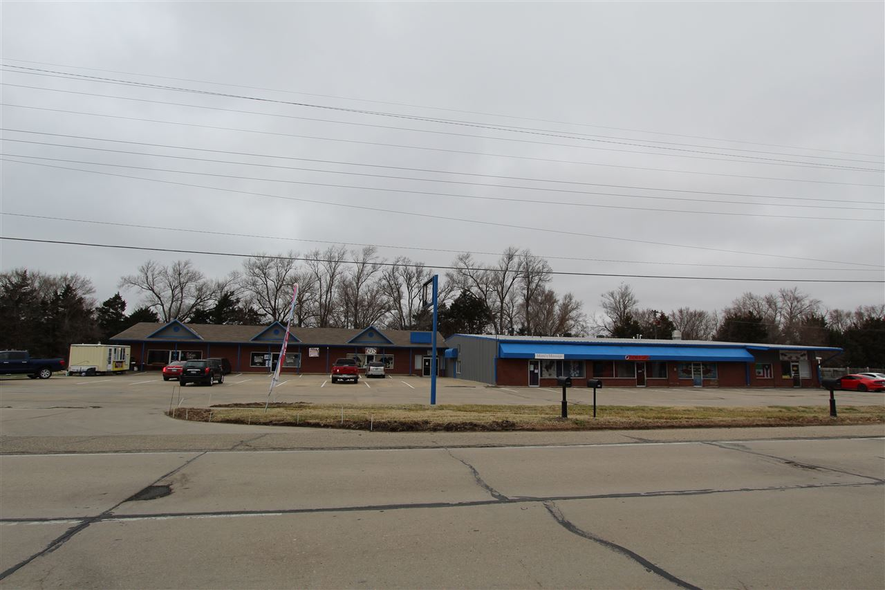 Great opportunity to own an income producing strip shopping center on Grant Ave. This property is in between Ft. Riley's Grant avenue and Trooper gates. All 8 units are currently leased.  Every unit has it's own bathroom, two units have 2 bathrooms and one unit has 2 bedrooms and 1 unit has a kitchen. Contact Kim Portillo 785-209-846 with any questions and personal viewing.