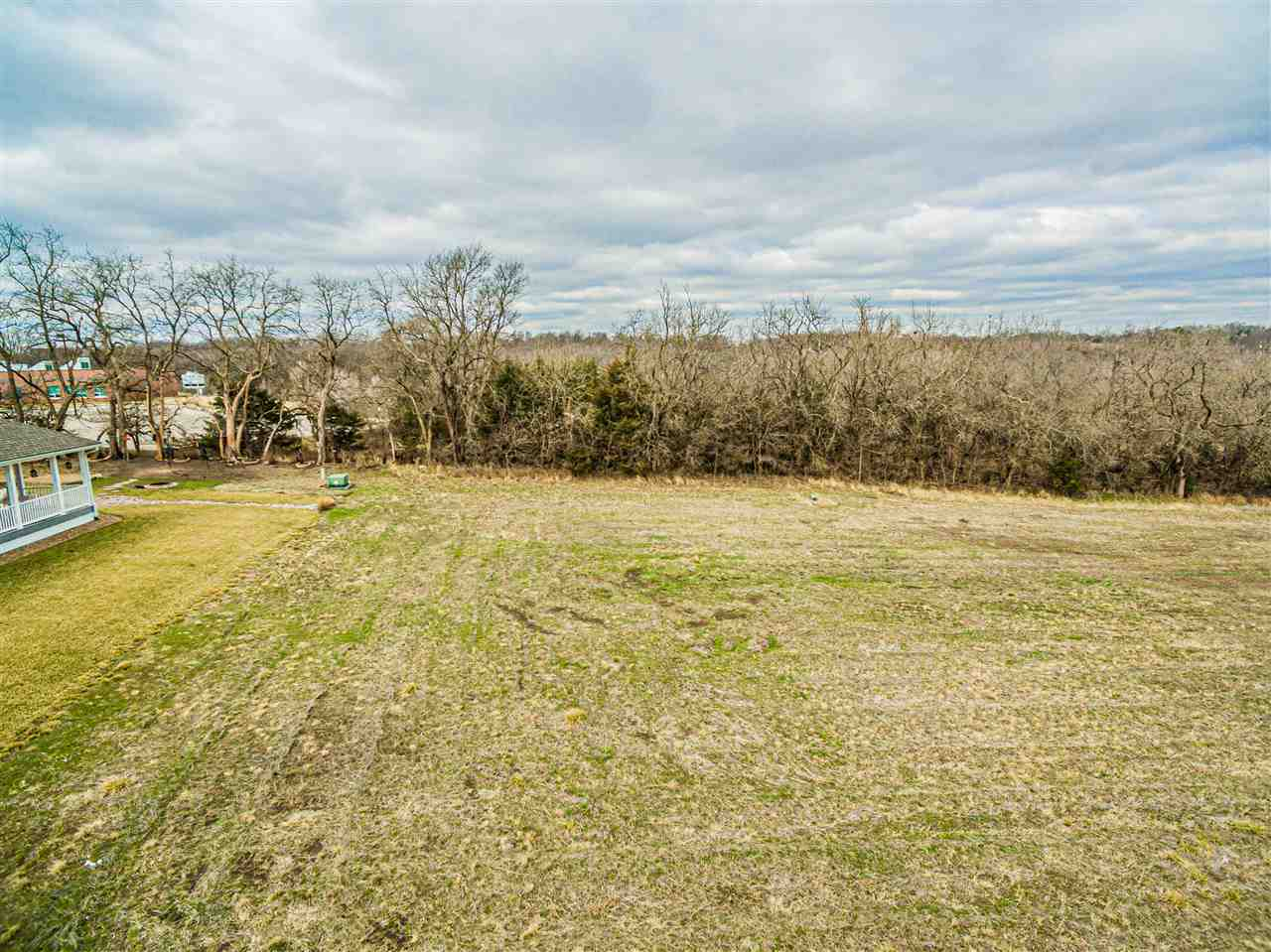 BUILD YOUR DREAM HOME-  Irish Acres Unit #3.  One of two lots available to build your dream home.  This 90x140 lot sits on the end of a private paved street. No specials!!!  This area has scenic views and wildlife close by. Minutes from I-70 Chapman Exit.  There is a 20' easement on the south, 30' easement on west on this property & covenants.  Call Becky @ NextHome Unlimited for more information @ 785.479.1920.
