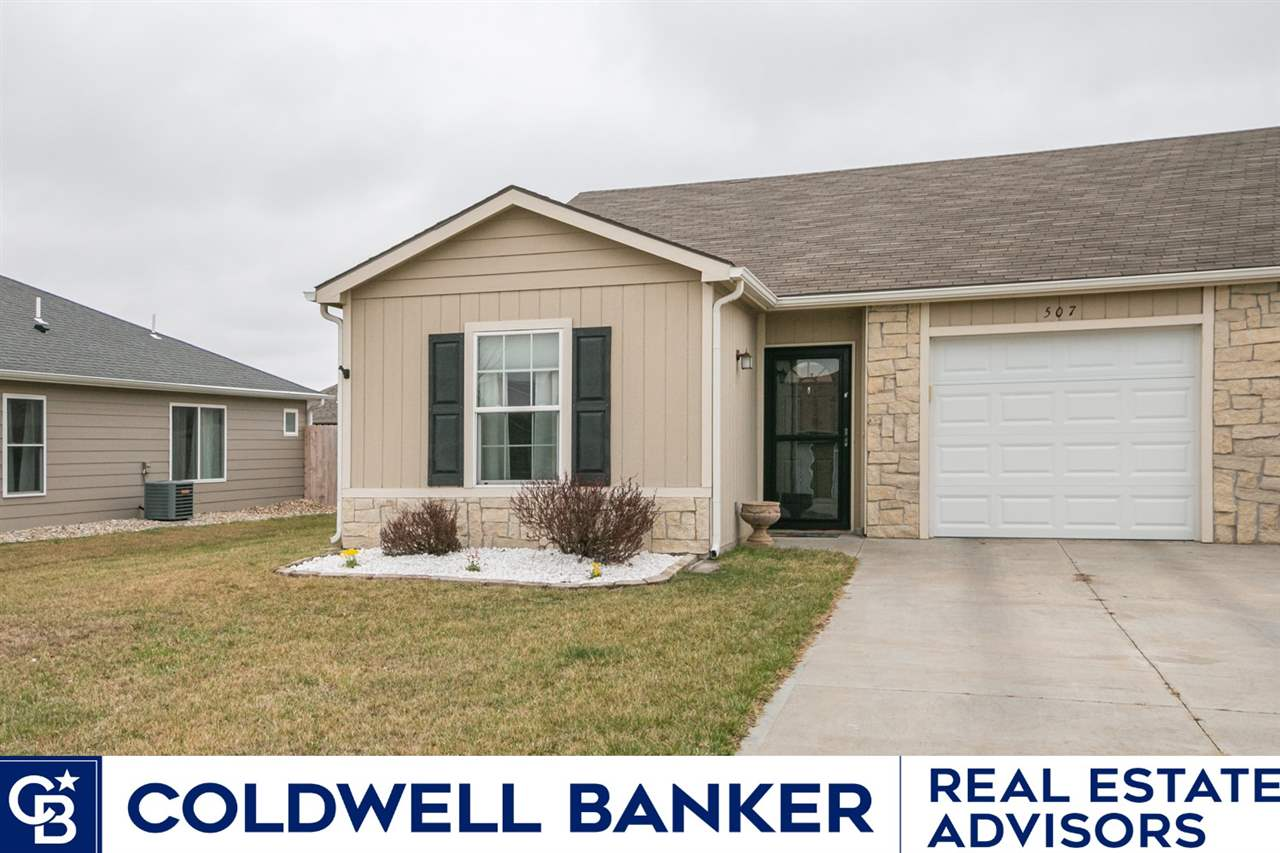 This well maintained home has had ALL INSPECTIONS COMPLETED and is move in ready! The home features two bedrooms each with their own bathroom and large walk in closets! The main living area is an open concept floorplan with a spacious living room that opens to the patio and fully fenced in backyard. The kitchen includes island with eating bar, and don't miss the additional pantry storage in the laundry room located right off the kitchen. For additional questions or to set up a showing of this home, contact Tara Claycamp at Coldwell Banker Real Estate Advisors 785-317-6826.