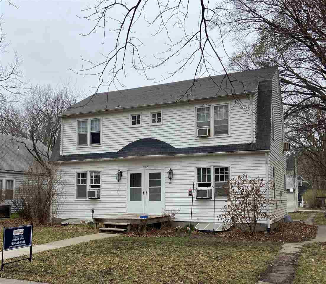 Have you been looking for a great investment opportunity near K-State?  The 2-story duplex offers two identical 2BR/1BA units plus 2BR/1BA basement apartment with egress windows. The four-car detached garage has two identical 1BR/1BA studio units above. Each unit is equipped with refrigerator and range.  A shared laundry unit is located in common basement area.