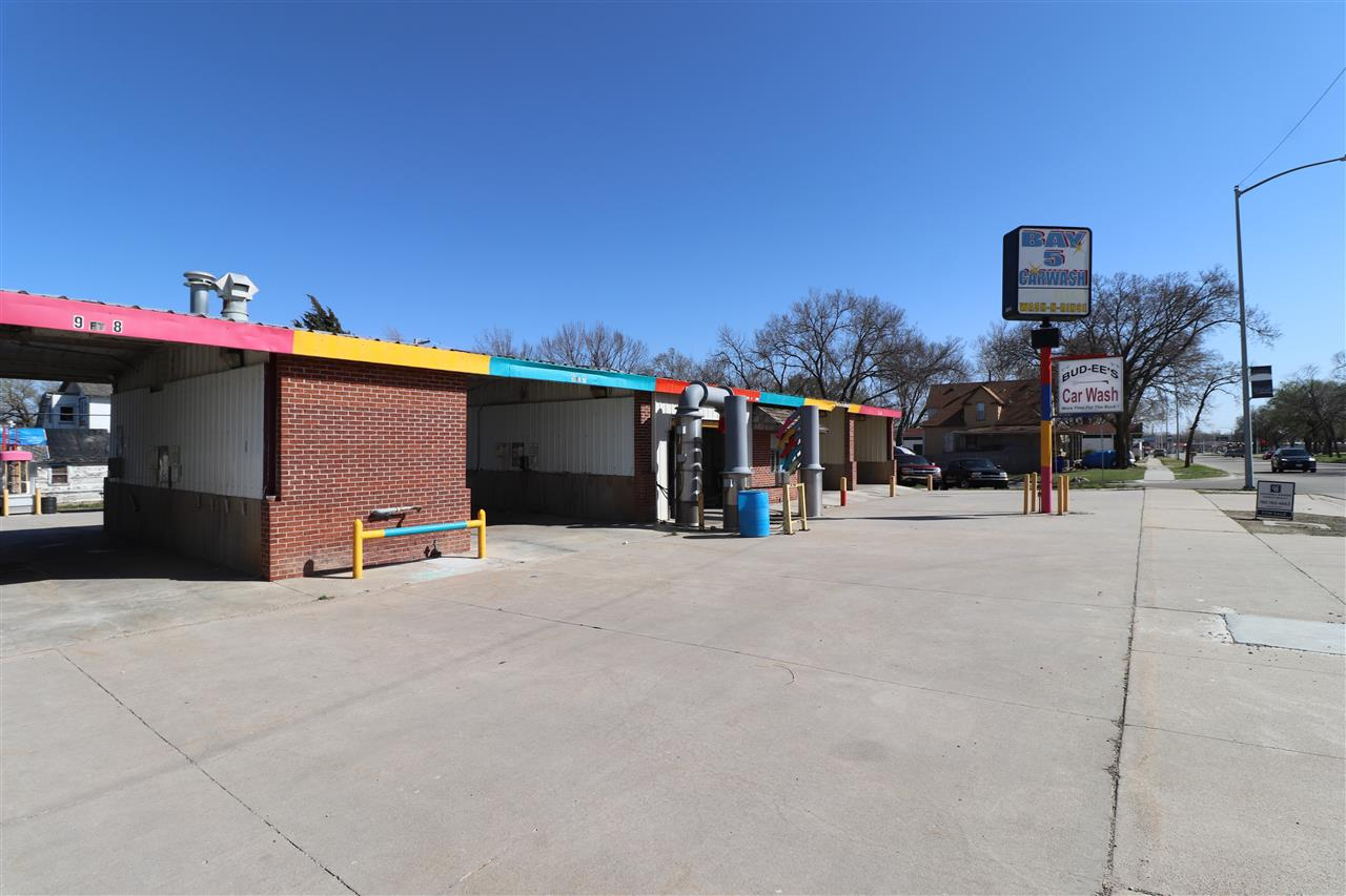 Car wash on paved city lot. There are 5 wash bays, 4 vacuums, vending machines and coin changer. The business sits on 4 city lots.