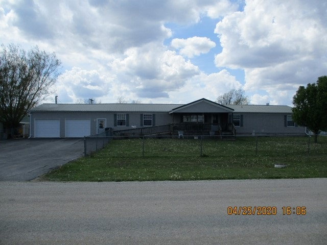 Back On The Market!! 3.7 acres on the east edge of White City, Ks., with all city utilities on the property. This spacious manufactured home is handicap accessible with 4 bed/2 full bath, a large eat-in kitchen w/pantry, 2 living room areas (1 w/wood burning fireplace), & utility room on the main floor. The basement area is 3/4 finished & has a living/kitchenette area, 1 full bath, & 2 non-conforming bedrooms. Home has a stair lift in the garage that goes to the basement area. Attached 2 car garage, along with a 30x60 detached garage/workshop area (propane heated). 36x26 carport & above ground pool also included. Large, gentle sloping lot with a tree lined ravine on the west edge of property. Close proximity to Junction City/Fort Riley, Manhattan, Herington, & Council Grove, White City is a great community to raise a family or to retire in. Owner occupied, 24 hr. notice required for showings. Call Today to set up your appointment!!