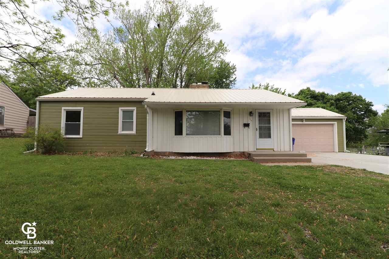 This affordable home is very nice and clean with an attached 2 car garage.  It is located very close to Lincoln Elementary and to the center of town.  You'll appreciate the attached 2 car garage as well as the fenced yard, and addition to the rear of the house.  Make it your workshop, office or add a closet and make it a 4th bedroom!  The roof is only 4 years old and the HVAC has been updated as well.  This is an excellent starter home or a great opportunity for 1 level living.   You'll love the mature trees and quiet neighborhood.
