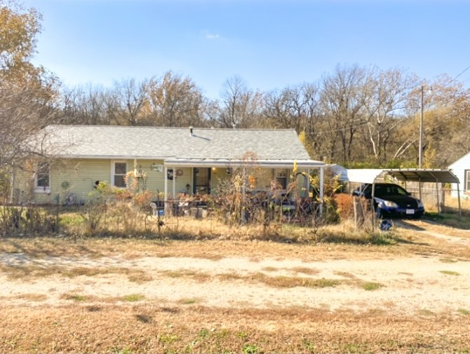 Country feel minutes from downtown Manhattan! Large lot zoned AG so tons of potential for Animal Lovers!! This 3 bed 1 bath home has newer flooring and large master bedroom and closet. Big detached garage along with other outbuildings as well as a carport! Numerous fencing throughout the property with private backyard. There are tons of opportunities with this price and location! Within walking distance to Wildwood Adventure Park.  Contact Erin Montgomery: 785-341-7387