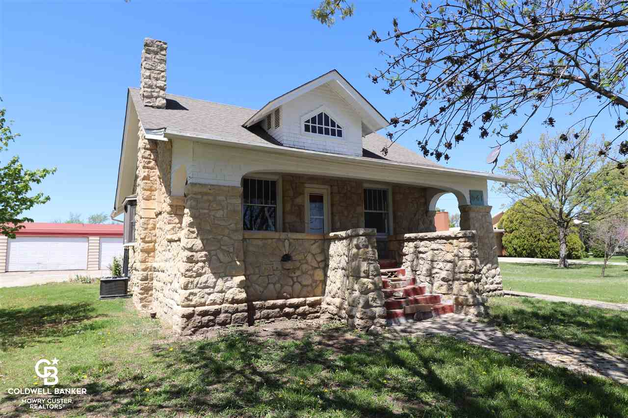 """One of a kind stone home with a full unfinished basement. This home has updated cabinetry in the kitchen, fresh interior paint, and a very unique fireplace. You'll love the 20 x 50 attached garage/shop combo. This is truly a unique find and a great place to call """"home""""."""
