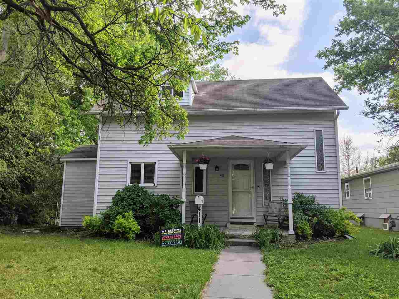 Charming 2 bedroom, 1.5 bathroom home located in central Manhattan. This location is ideal as it is within walking distance to local shops, schools, and K-State. This home offers plenty of space and charm. The foyer and living room are big and open. The eat-in kitchen has the perfect spot for a dining table. There is a half bathroom on the main floor for convenience. Upstairs is the master bedroom, updated, full bathroom, and second bedroom. The basement offers room for storage and a safe place to go during a storm. The backyard is fully fenced, has a storage shed, lots of room to run around and enjoy the outdoors, and has alley access and extra parking. Don't let this one get away from you. Call Lauren at 785-564-2693 to schedule your showing today!
