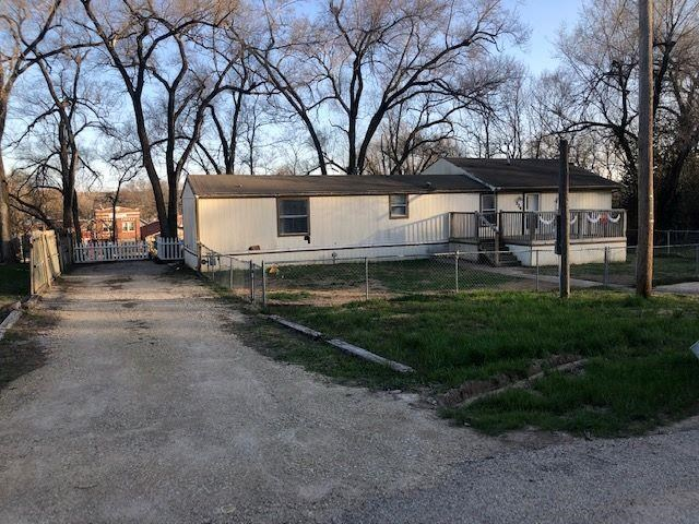 Fantastic buy! Way cheaper than rent, & super close to Post! This 3 bedroom 2 bath home is move in ready with a Master Suite, walk in closet,& formal dining room. The front yard boasts a large front deck and fenced yard and the backyard boasts a large covered deck. There's off street parking as well! This home is manufactured mobile home with an addition and does not have a permanent foundation. Call Kelly Niemczyk at 785-375-8300 for viewings.