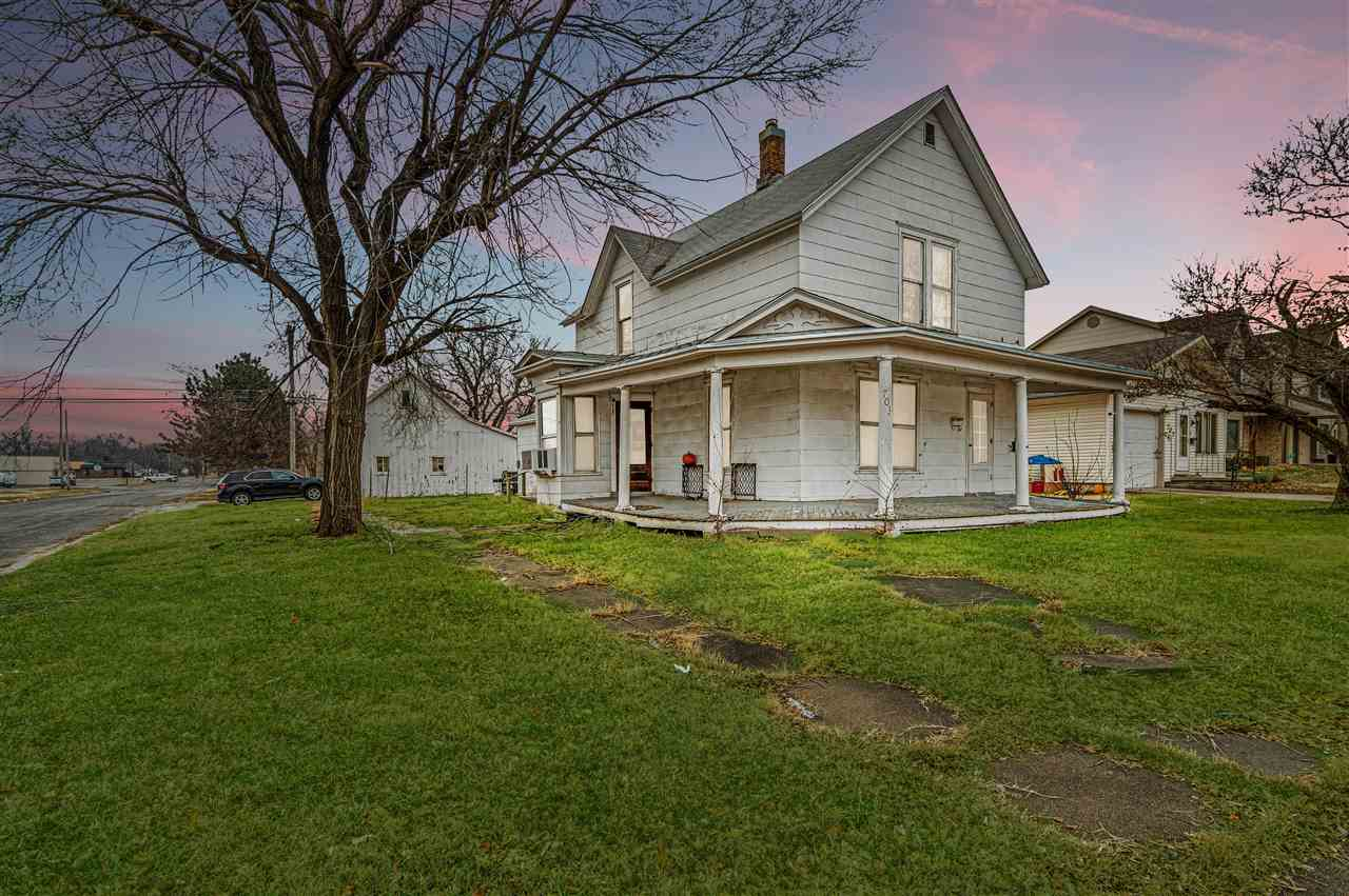 This spacious 4 bedroom 2 bathroom home sits on a corner lot in a very central location of town. It features hardwood floors on the main level, a partially remodeled bathroom, and in the back yard sits a detached 2 car garage.