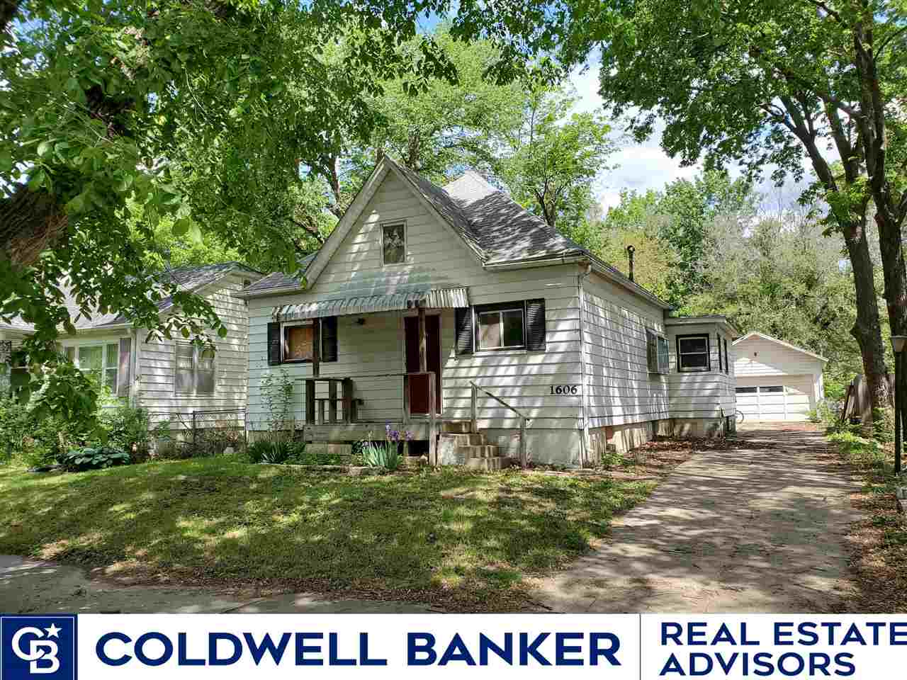 Great project or flip property!  Great bones for someone to create an up to date floor plan! Located across from Long's Park!  Remodelers check this out!  Travis Hecht 785-294-1128 for more details.