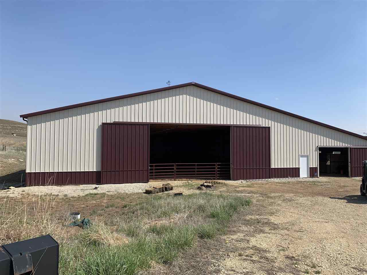 Location location location residential building site located  just 7 miles from town. Property has a 120 x 104 Morton building. 100 x 80 is a riding arena and 120 x 24 has 6 stalls and a tack area on 5 acres m/l. Hay shed 60 x 30 and 24 x 14 shed to the south goes with this property