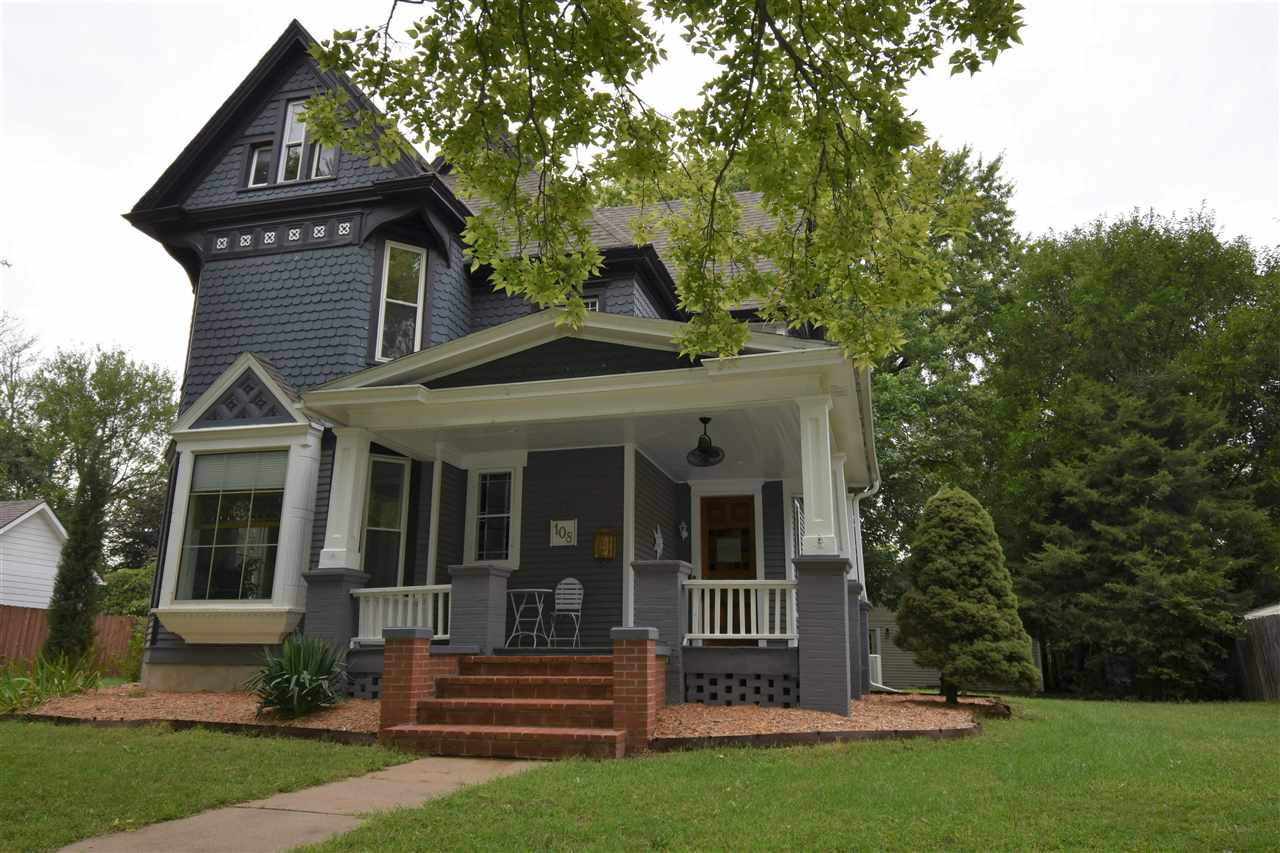Turn of the Century, Beautiful Home.  Total Renovation throughout, sheetrock, windows, electrical, plumbing, lighting, heating and air units.  Newer Roof, fresh paint in areas.  Formal living room (parlor) with fireplace, pocket doors open to the formal dining area, family room and spacious kitchen.   Bay windows, stain glass, decorative molding.  Open spindled staircase greets you at the front entryway.  The kitchen has 2 metal bank doors that lead up the back staircase that is decorated with old license plates. 3/4 bath in between the kitchen and family room. Each fixture throughout is unique and interesting. Upstairs features 3 spacious bedrooms, a full bath, laundry room. Off the laundry room is a sun porch with an abundance of windows. This home has an additional 3 outside porch areas. Nice basement accessible through kitchen or outside entryway. 3 car garage.