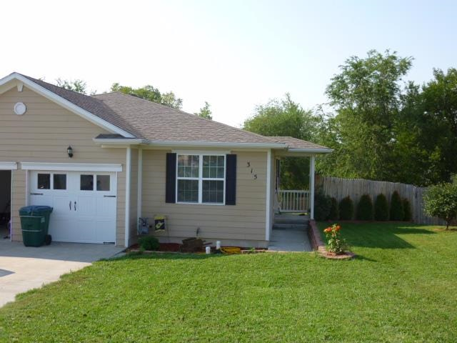 This spacious 1/2 duplex is walking distance to the award winning Chapman Elementary and Middle school. The home has 2 bedroom and 2 bathrooms on the main level. In the walkout basement, you will find a giant 3rd bedroom, 3rd bathroom, and a family room- perfect for a home theater. Out back, the huge fenced yard is ready for all your summer activities! Call Raygen Battishill with Coldwell Banker Patriot Realty to schedule your showing!
