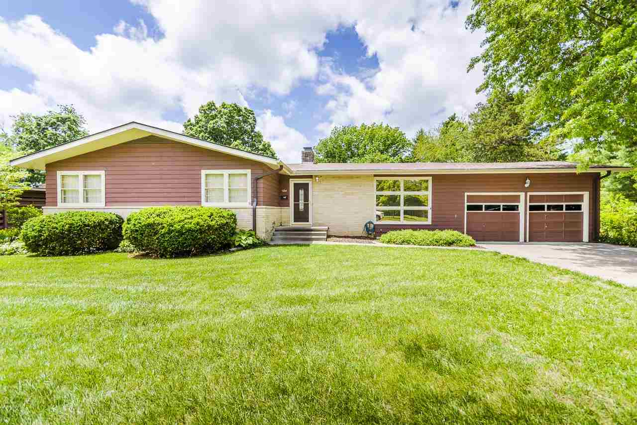 Located in a prime position and set in an beautifully landscaped yard, this well maintained home is ready for a new owner to put their own touches on it!  Now is your chance to be the next owner in this highly desired central location!! Just a few of the many highlights include: two fireplaces, beautiful original wood floors, lots of windows allowing in natural light, an updated kitchen, main floor laundry, a covered patio, a nice private backyard, and it has been exceptionally cared for!!