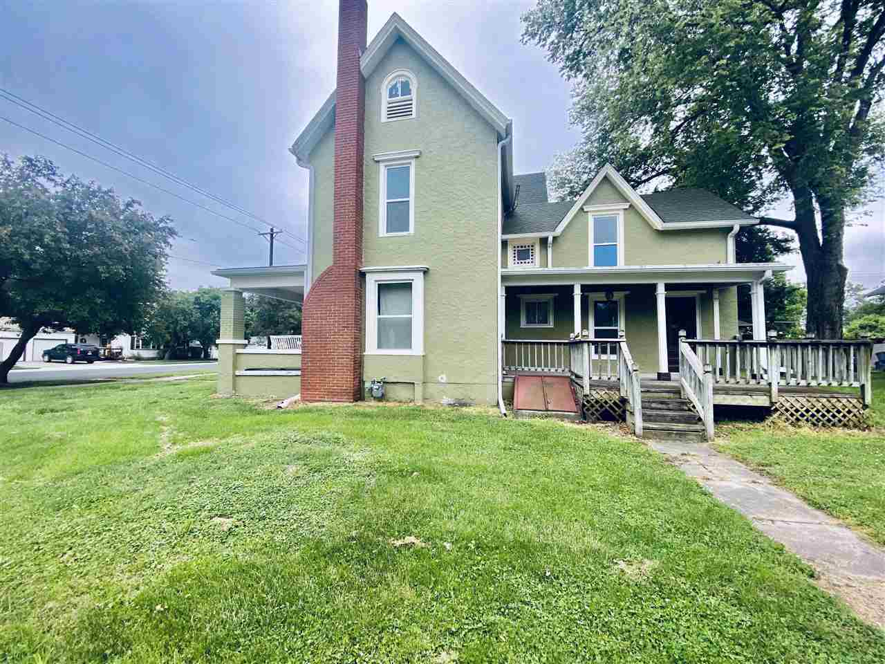 """This is your opportunity to finish a project that is close to being done.  Being sold """"as is"""".  Has had new wiring, plumbing, roof, windows, and siding done.  The kitchen has new cabinets and countertops and main floor bathroom is remodeled as well.  There are original wood floors on the majority of the main floor.  Five total bedrooms in this home with one on the main floor.  Lots of square footage for a family to spread out located close to Garfield elementary and downtown businesses."""