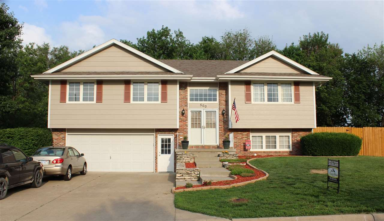 3 bedroom 2 1/2 bath custom built Mike Wilson home. Located on large corner lot. Bi-level house with an open concept, Spacious living room, dining room and kitchen area with tall ceilings. Oak kitchen cabinetry with island and plenty of storage. Enjoy the back deck and backyard right off the dining room patio doors. Country view of a field.  Largest bedroom on the main level has a bath and dual closets. 2 bedrooms and a full bath on the main level as well. Downstairs is a large family room, small bar area, 1/2 bath and laundry room.  2 car garage has heating and air with a space for work benches. Utility shed, in ground sprinkler system. Exterior painted in 2020. NO SPECIALS! 20x20 patio area, 14 x 12 deck. Give Shelly with Almost Home Realty a call to see your new home 785.263.5028.